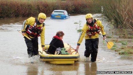 A woman is rescued by firefighters in Longburton
