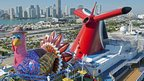 A giant inflatable cartoon Thanksgiving turkey is perched on the Carnival Breeze after it was inflated following the ship's arrival in Miami, 21 November 2012
