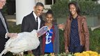 President Barack Obama, with daughters Sasha, centre, and Malia, right, carries on the Thanksgiving tradition of saving a turkey from the dinner table with a &quot;presidential pardon,&quot; at the White House 21 November 2012