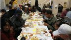 Homeless and poor people eat Thanksgiving dinner at CityTeam Ministries in Oakland, California