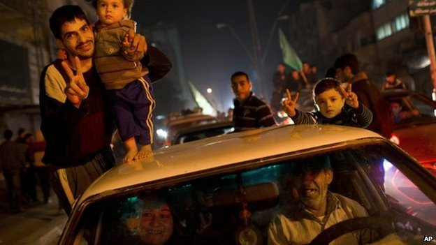 Palestinians celebrate the Israel-Hamas ceasefire in Gaza
