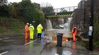 Flooding from a railway bridge has closed the A357 in Templecombe