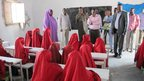 The mayor speaks to a class of girls at an orphanage in Mogadishu