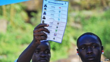 An election scrutiniser counts a ballot at a polling station in Freetown, Sierra Leone, on 17 November 2012