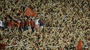 Fans cheer during an Independiente  match on 1 November
