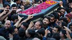 Pakistani Shiite Muslims carry a coffin