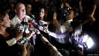 Ernesto Torres surrounded by journalists