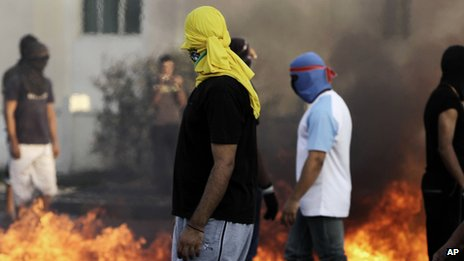 Masked Bahraini anti-government protesters set tires on fire in the village of Malkiya. Photo: November 2012