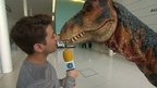 Dinosaur steals Ricky's microphone