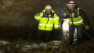 Examining rubble left in collapsed Neburn Culvert