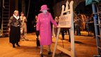 The Queen unveils a plaque to reopen the royal box