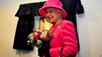 The Queen reveals a plaque at the Gatehouse Centre in Hartcliffe