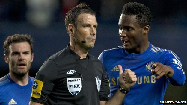 Referee Mark Clattenburg and Chelsea's John Mikel Obi