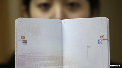 A woman holds the new Chinese passport on 23 November 2012