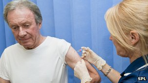 Man getting the seasonal flu jab