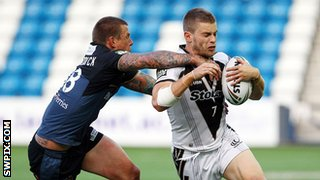 Rhys Hanbury of Widnes Vikings is tackled by Hull FC's Ryan McGoldrick