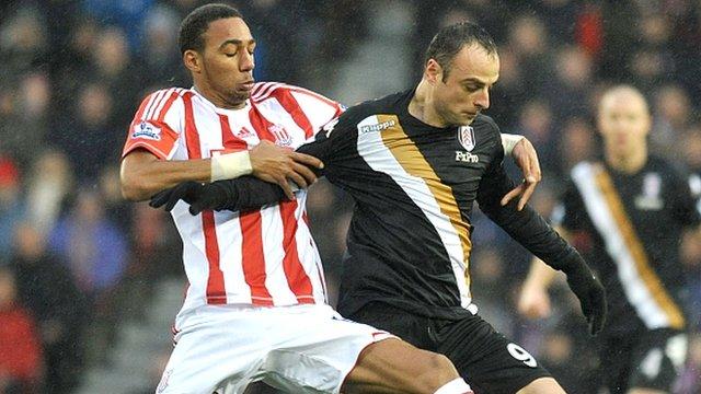 Stoke's Steven N'Zonzi battles with Fulham's Dimitar Berbatov