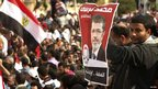 Supporters of Egyptian President Mohammed Mursi outside the presidential palace in Cairo on 23/11/2012
