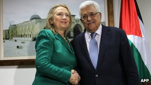 US Secretary of State Hillary Clinton shakes hands with Palestinian President Mahmoud Abbas