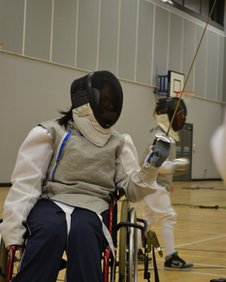 Karen Sutherland competes from her wheelchair against able-bodied fencers