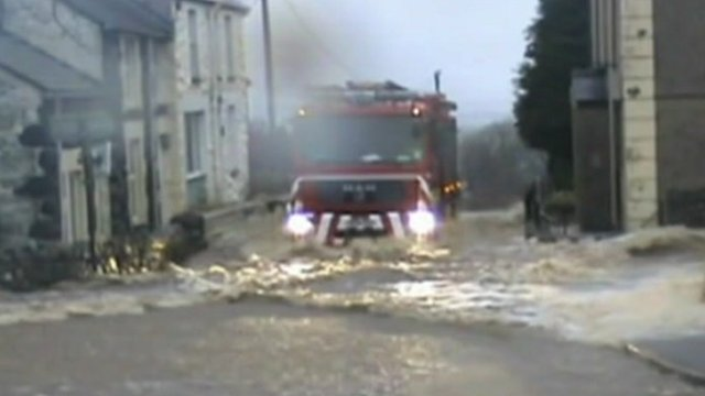 Fire engine travels through flash flood