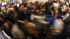 Customers rush into the Macy's in New York on 23 November 2012