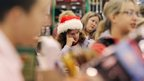 Lisa Wagner, of West Bend, rests her head on her hand while waiting to check out at Menards, early on 23 November 2012