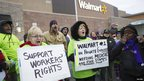 Protesters demonstrate outside a Walmart store in Chicago on 23 November 2012