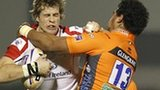 Ulster wing Andrew Trimble feels the full force of this tackle from Christian Loamanu
