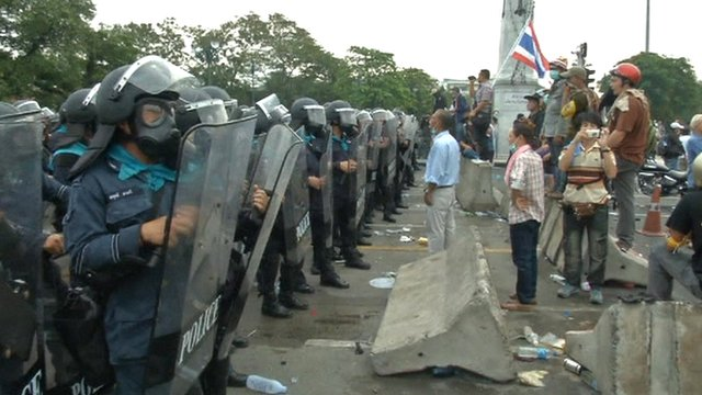 Police face protesters in Thailand