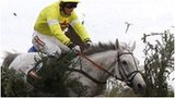 Neptune Collonges jumps the Chair on his way to victory in the 2012 Grand National
