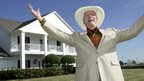 Larry Hagman poses in front of the Southfork Ranch mansion in Parker, Texas made famous in the television show Dallas (file image from 9 Oct 2008).