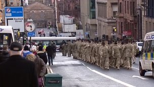 The troops take part in a homecoming parade