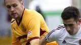 Motherwell's Tom Hateley tackles Jamie Walker of Hearts