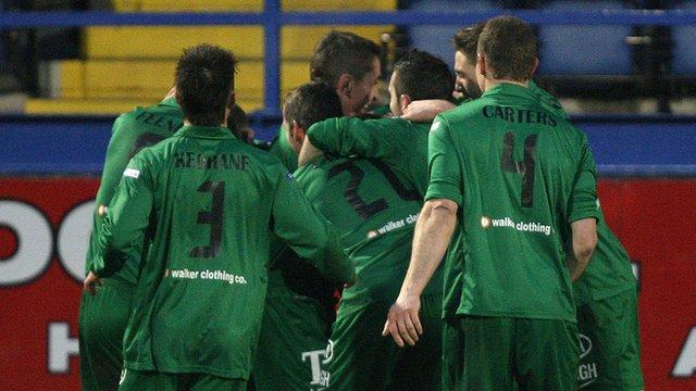 Ballinamallard players celebrate with goalscorer David Kee
