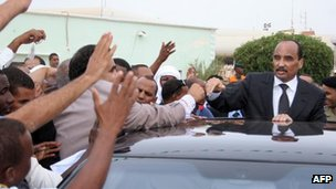 President Abdelaziz waves to crowds