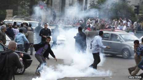 Tear gas fired at anti-Mursi protesters during clashes in front of the Supreme Judicial Council in Cairo on 24 November.