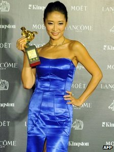 Chinese actress Liang Jing holds a Golden Horse trophy after winning the best supporting actress award