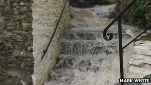 Water running down steps in Polperro
