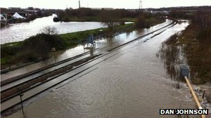 A photograph of a flooded railway line in the Rotherham area