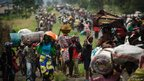 Thousands of people in the Democratic Republic of Congo flee the town of Sake, west of Goma,