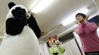 Choko Oohira (right) teaches trainees in character mascots at the Choko Group mascot school in Tokyo