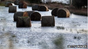 Hay bails in flooded field