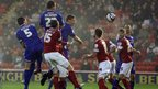 Ben Nugent (centre) raises to meet Peter Whittingham's corner to put Cardiff City ahead against Barnsley