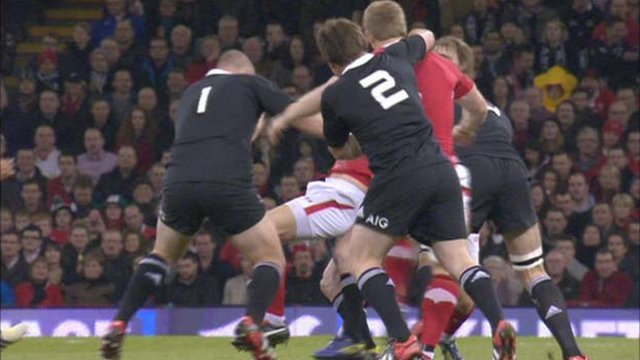 New Zealand hooker Andrew Hore strikes Wales lock Bradley Davies