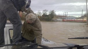 David Dunn helps man out of flooded car