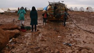 Internally displaced Syrians at a water source in the Atma refugee camp in northern Syria
