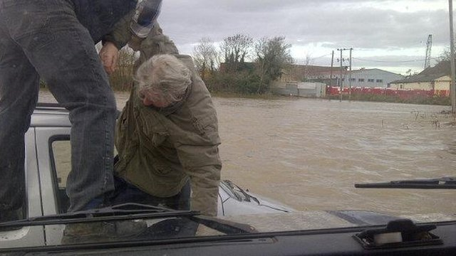 David Dunn pulls an elderly man from his car as it sinks in flood water at Keynsham