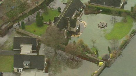 Homes in Cirencester surrounded by flood water