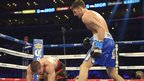 Nathan Cleverly knocks down Shawn Hawk in Los Angeles to successfully defend his WBO light-heavyweight title